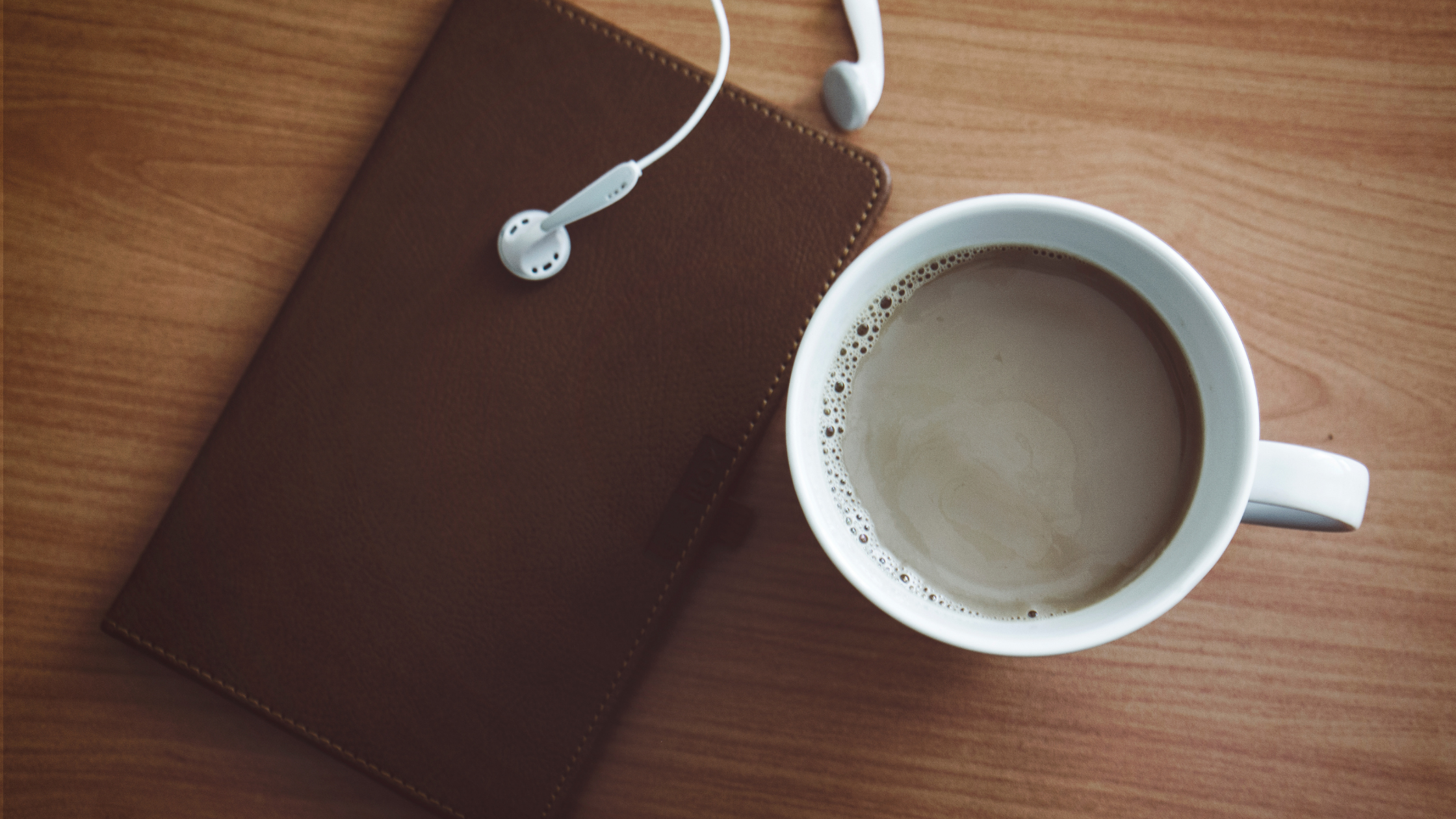 Engaging scripture - coffee and earbuds